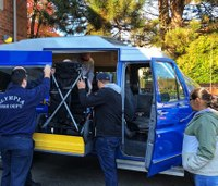 Firefighters present wheelchair van to mother of disabled son