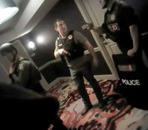 In this Oct. 1, 2017, file image from police body cam video released by the Las Vegas Metropolitan Police Department on July 25, 2018, shows law enforcement officers in a hallway at the Mandalay Bay Resort and Casino while searching for a shooter in Las Vegas. (Las Vegas Metropolitan Police Department via AP, File)