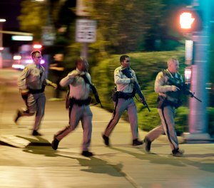 In this Oct. 1, 2017, file photo, police run toward the scene of a shooting near the Mandalay Bay resort and casino on the Las Vegas Strip in Las Vegas. In documents made public Thursday, Dec. 27, 2018, police in Las Vegas have released transcripts of some officers' accounts about what they saw, heard and did trying to locate and stop a gunman who unleashed the deadliest mass shooting in the nation's modern history almost 15 months earlier. (AP Photo/John Locher, File)
