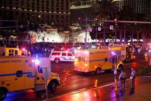 In this Dec. 20, 2015 file photo, police and emergency crews respond to the scene of an incident along Las Vegas Boulevard, in Las Vegas. Crime is spiking in Las Vegas and spurring questions about causes and cures. (AP Photo/John Locher, File)