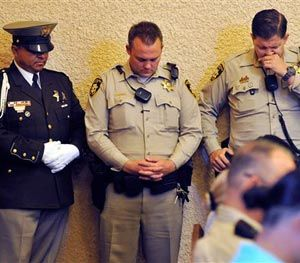 Las Vegas police bow their heads during a memorial service for Joseph Wilcox at Palm Downtown Mortuary on Sunday, June 22, 2014, in Las Vegas. (AP Image)