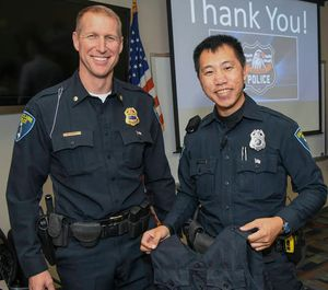 Deputy Chief of Police Matt Rokus (left) issues Eau Claire police officer Mark Vang his load-bearing vest. (Photo/University of Wisconsin-Eau Claire)