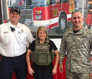 Ada County Paramedics' Tactical Medical Team member Kevin Luby stands with Connie Judd, a Firehouse Subs Area Developer. Ada County Paramedics TacMed member Cody Porter is on the right. (Photo/Ada County Paramedics)