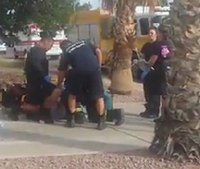 Video: Firefighters fight back against patient who assaulted them