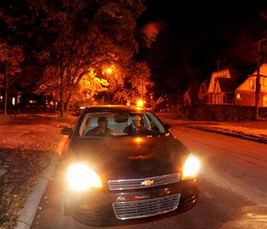 Volunteers patrol their neighborhood in Detroit, Mich., keeping an eye out for fires and suspicious behavior. (AP Photo/Detroit News, Ricardo Thomas)