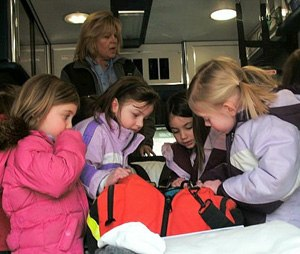 In this photo, kids explore an ambulance during a show and tell. Taking the ambulance out to interact with the public is great practice which builds confidence in low-volume providers and develops a rapport with the community. (Image Nancy Magee)