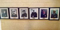 Firefighter who removed chiefs' photos citing racism settles