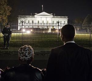 "Four students from Howard University, who asked only to be called ""Mike Brown"", pray in front of the White House, Monday, Nov. 24, 2014, in Washington, after the Ferguson grand jury decided not to indict police officer Darren Wilson in the shooting death of Michael Brown. (AP Image)"