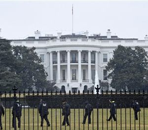 In this Jan. 26, 2015 file photo, Secret Service officers search the south grounds of the White House in Washington after an unmanned aerial drone was found on the White House grounds. (AP Image)