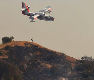 A Bombardier 415 Super Scooper aircraft comes in for a water drop below East Camino Cielo in the hills above Montecito, Calif. (Mike Eliason/Santa Barbara County Fire Department via AP)