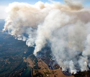 Smoke rises as a wildfire burns in the hills north east of Napa, Calif. (Michael Short/San Francisco Chronicle via AP)