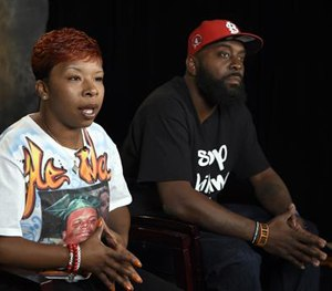 The parents of Michael Brown, Lesley McSpadden, left, and Michael Brown, Sr., right, sit for an interview with The Associated Press in Washington. (AP Image)