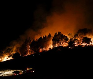 Firefighters watch from their fire trucks as wildfires continue to burn near Calistoga, Calif. (AP Photo/Jae C. Hong)
