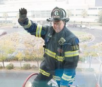 Firefighter reaches high to lift young ICU patient's spirits