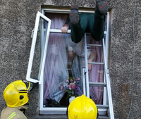 Hero of the Week: Medic squeezes through 'wee hopper window' to save woman