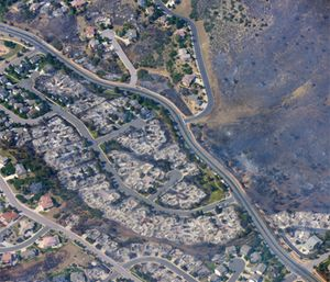 This aerial photo shows burned homes in the Mountain Shadows residential area of Colorado Springs, Colo., that were destroyed by the Waldo Canyon wildfire. (AP Photo/John Wark)