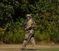 Manhunt for Pa. ambush suspect centers on dense woods