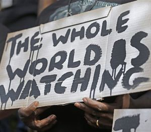 A man holds a sign during a protest for the shooting death of Walter Scott at city hall in North Charleston, S.C., Wednesday, April 8, 2015. (AP Image)