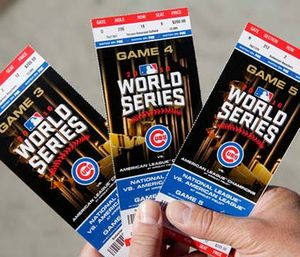Chicago Cubs baseball fan Robert Lyons, who lives in Los Angeles and was raised in Berwyn, Ill., shows his World Series tickets outside Wrigley Field. (Michael Tercha/Chicago Tribune via AP)