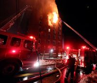 Firefighters struggle against fatal apartment fire in freezing temperatures