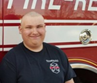 Photo: Jr. firefighter goes bald to honor firefighter brother's memory