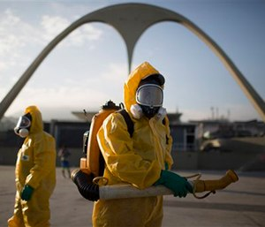 A health worker stands in the Sambadrome as he sprays insecticide to combat the Aedes aegypti mosquitoes that transmits the Zika virus in Rio de Janeiro, Brazil. (AP Photo/Leo Correa)