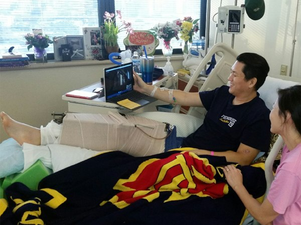 An and his wife viewing via Skype the special presentation to Dallas Police Department officers. (Photo/Dallas Fire-Rescue via Twitter)