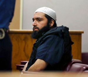 In this Dec. 20, 2016 file photo, Ahmad Khan Rahimi, the man accused of setting off bombs in New Jersey and New York's Chelsea neighborhood in September, sits in court in Elizabeth, N.J. Prosecutors are urging a judge to impose a life sentence on Rahimi. (AP Photo/Mel Evans, File)
