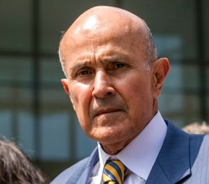 In this May 12, 2017, file photo, former Los Angeles County Sheriff Lee Baca leaves federal court in Los Angeles. (AP Photo/Damian Dovarganes, File)