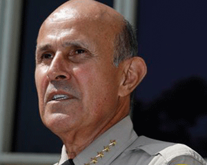 This Sept. 28, 2011 photo shows Los Angeles County Sheriff Lee Baca, who announced he will be retiring in the wake of a recent corruption scandal and investigation. (AP Photo/Damian Dovarganes, file)
