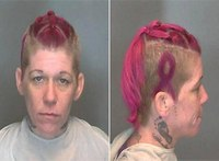 Ill. woman's mug shot displays breast cancer ribbon hairdo