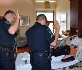 Jose Rubio-Pavon, diagnosed with an inoperable brain tumor, was sworn in as an officer in his hospice room. (Brighton Police Image)