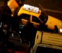 Video: NYPD lift taxi off man
