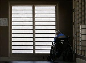 In this July 24, 2014 file photo, an inmate sits by a window at the mental health unit at the California Department of Corrections and Rehabilitation's Stockton Health Facility in Stockton, Calif. (AP Photo/Rich Pedroncelli, file)