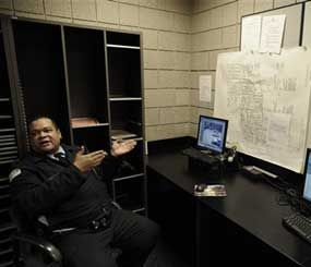 In this photo taken March 19, 2010 in Chicago, Chicago Police Officer Tony Washington talks about surveillance cameras while at the 18th District Police Station, across the street from a Cabrini Green Housing Project building. (AP Photo)