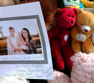 In this Aug. 16, 2018, file photo, a photograph of Shanann Watts and her daughters, Bella, 4, left, and Celeste, 3, is shown at a makeshift memorial in Frederick, Colo. (AP Photo/David Zalubowski, file)