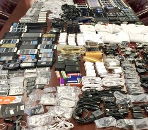 In this photo made available by the South Carolina Department of Corrections on Wednesday, April 6, 2016, shows cell phones that were seized in a single raid from the Lee Correctional Institution, S.C. (Stephanie Givens/South Carolina Department of Corrections via AP)