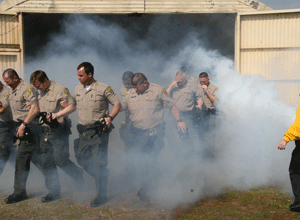 Correctional trainees are exposed to chemical agents. (Photo CDCR)