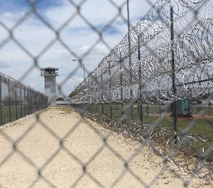 This Wednesday, June 21, 2017 photo shows barbed wire surrounding the prison in Gatesville, Texas. (AP Photo/Jaime Dunaway)
