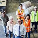 warehouse-and-industry-workers-in-australia-team-looking-at-camera-picture-id916456330.jpg