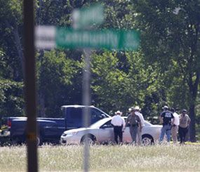 McKinney police block off the campus of Collin College after an active shooter incident outside the nearby McKinney Public Safety Building. (AP Photo)