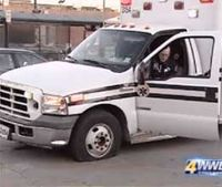 Man who 'booted' ambulance fired, cited