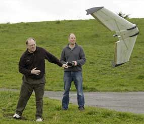 In this March, 28, 2012, photo, Mark Harrison, left, and Andreas Oesterer, right, watch as a Ritewing Zephyr II drone lifts off at a waterfront park in Berkeley, Calif. Interest in the domestic use of drones is surging among public agencies and private citizens alike. (AP Photo/Eric Risberg)
