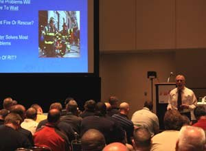 Photo Jamie ThompsonChief Dunne presents at FDIC on Thursday.