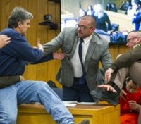 Video: Victims' father tries to attack disgraced ex-sports doctor in courtroom