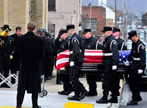 Corrections officers carry the casket of fellow Officer Eric Williams into Holy Trinity Church in Nanticoke, Pa. (AP Photo/The Times Leader, Aimee Dilger, File)
