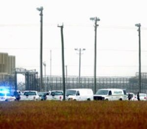 In this Thursday, Oct. 12, 2017 photo, police vehicles are seen outside Pasquotank Correctional Institution in Elizabeth City, N.C. (Thomas J. Turney /The Daily Advance via AP)