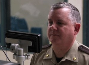 Anoka County jail Cmdr. Dave Pacholl demonstrates how a new iris scanning system works in the release station at the Anoka County Jail. The scan, which is simply a high-quality photograph, takes less time to obtain than fingerprints. (Photo Star Tribune)