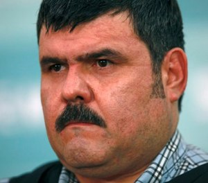 "In this Sept. 13, 2012 file photo, alleged leader of the Gulf drug cartel, Jorge Eduardo Costilla Sanchez, aka ""El Coss,"" is shown during a media presentation at the Mexican Navy's Center for Advanced Naval Studies in Mexico City. (AP Photo/Dario Lopez-Mills, File)"
