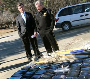 South Carolina Corrections Director Bryan Stirling and Richland County Sheriff Leon Lott talk after a news conference outside Broad River Correctional Institution in Columbia, S.C., Wednesday, Jan. 31, 2018. (AP Photo/Meg Kinnard)